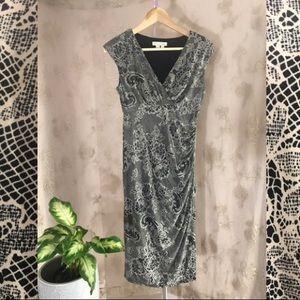 Beautiful lace print faux wrap dress!